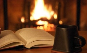 book by fire with coffee mug