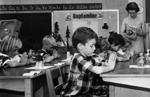 children praying in 1962